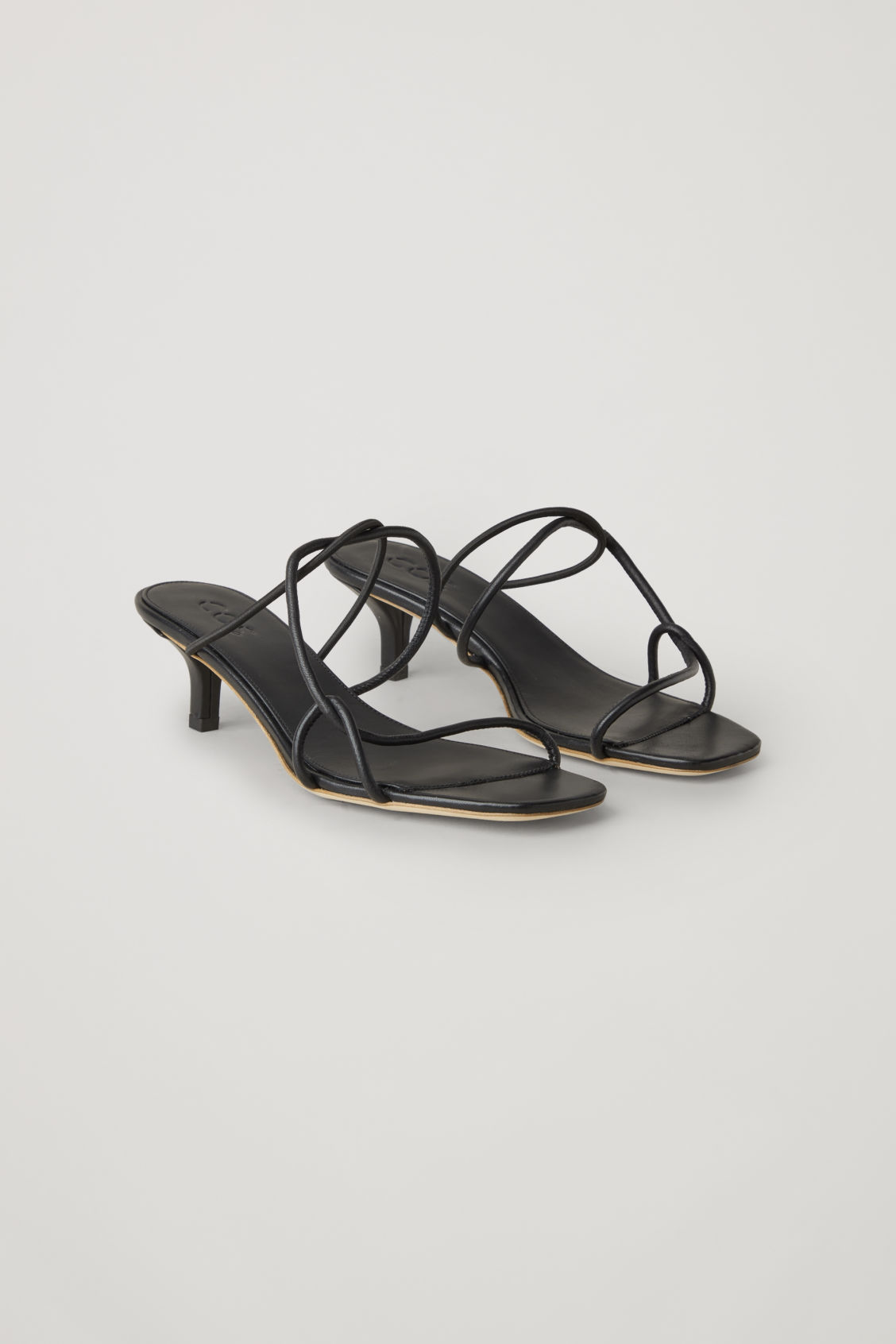 Front image of Cos strappy leather sandals in black