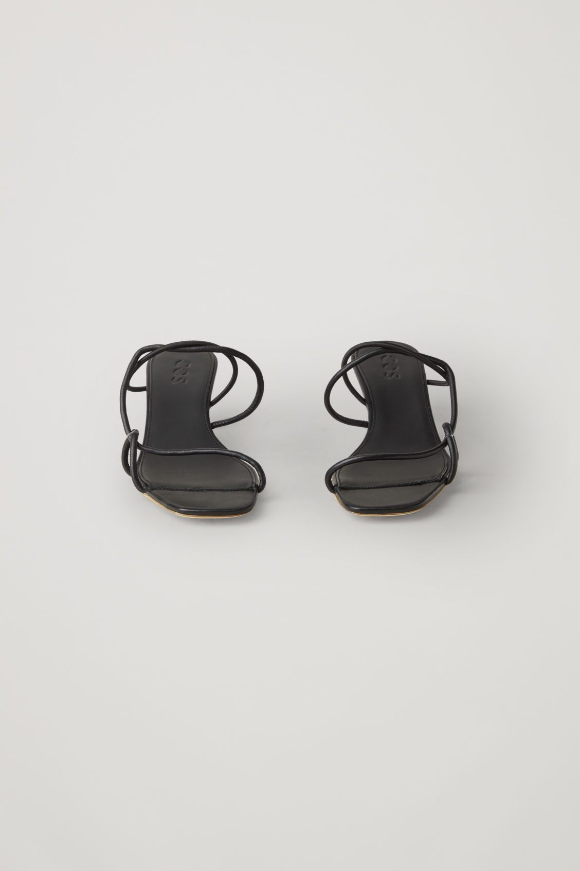 Side image of Cos strappy leather sandals in black