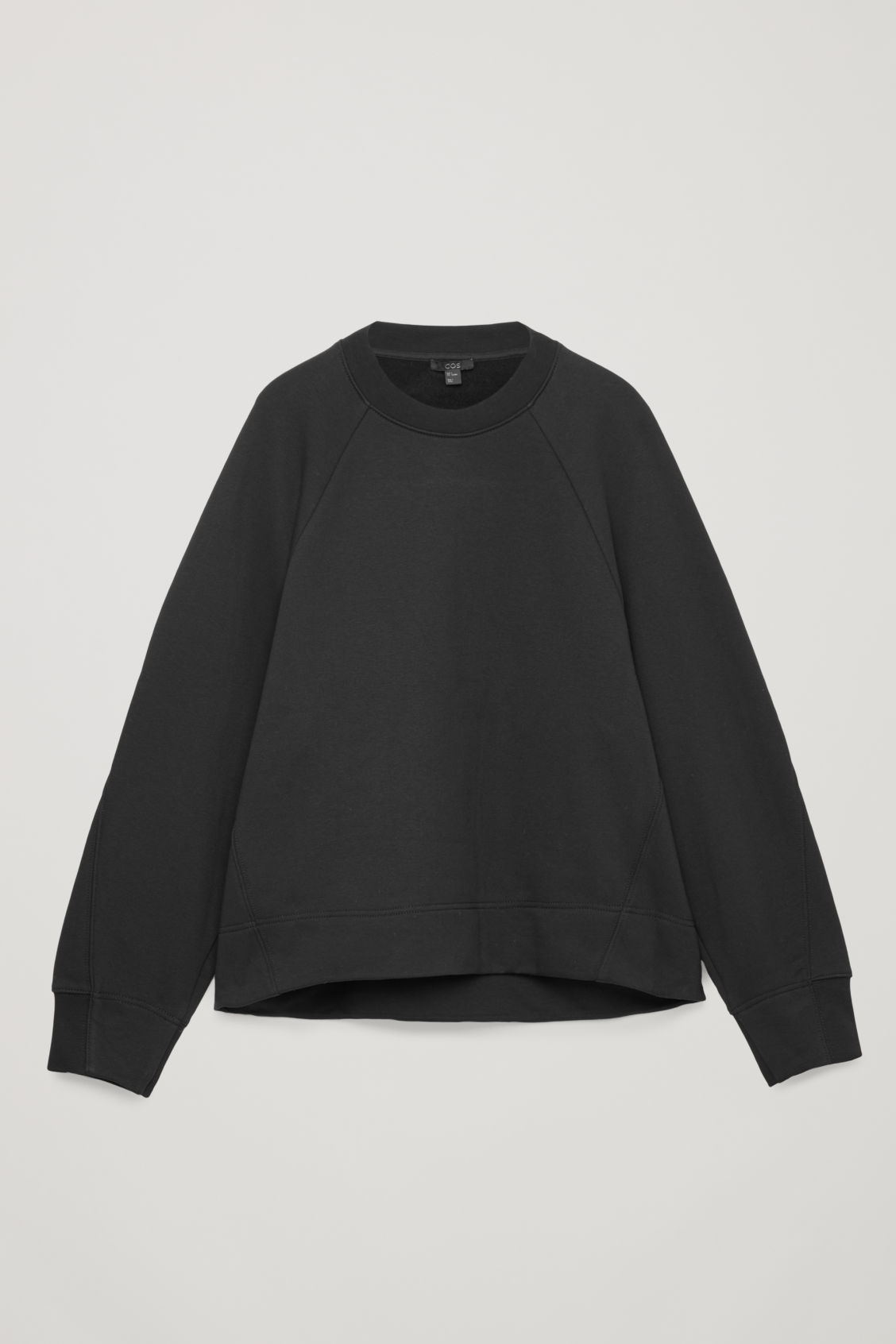 Front image of Cos sweatshirt with shaped sleeves in black