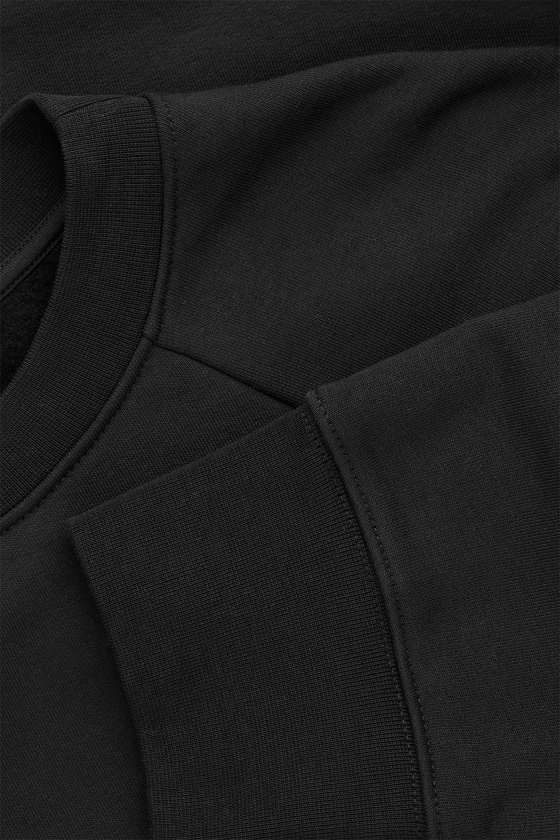 Side image of Cos sweatshirt with shaped sleeves in black