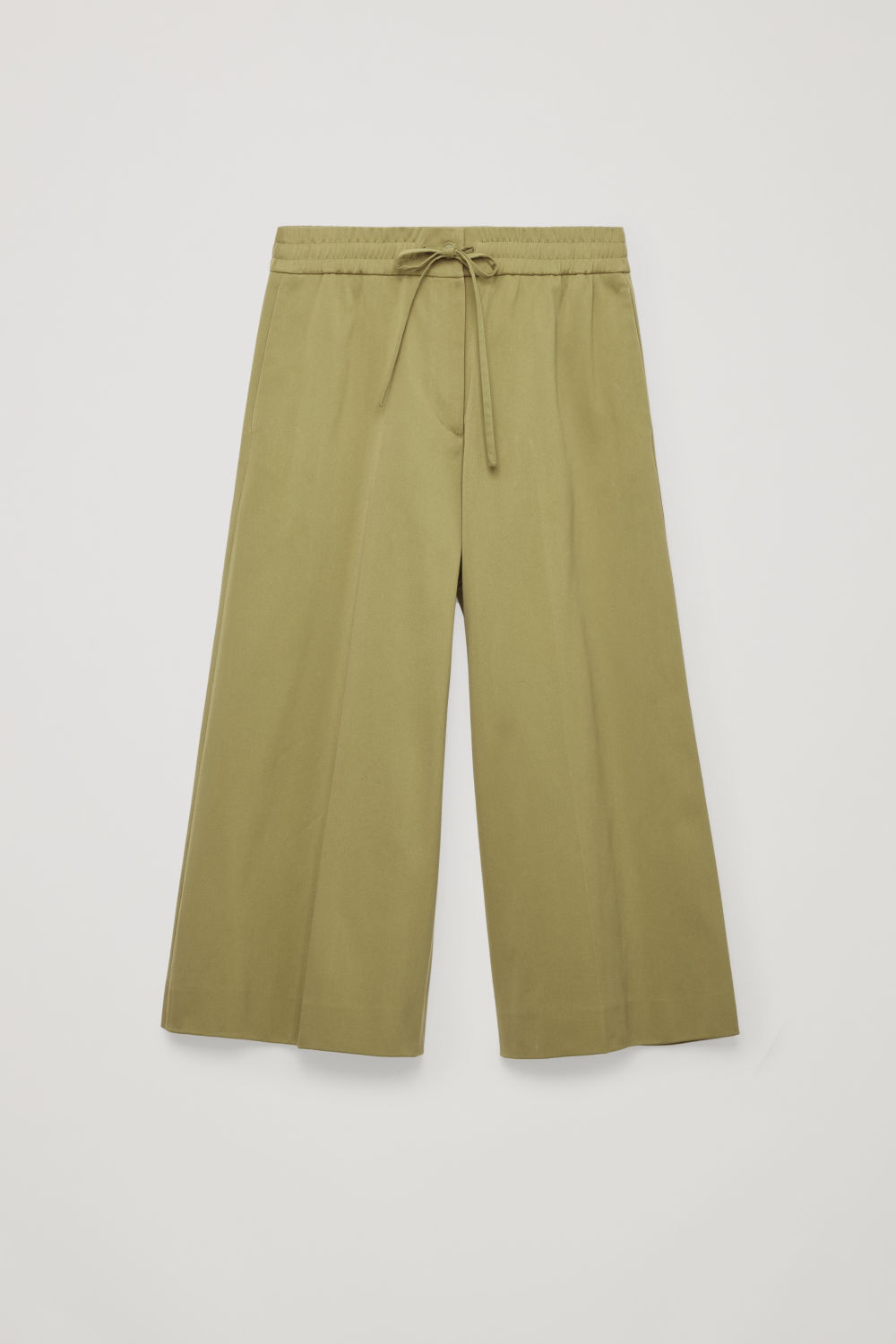 Front image of Cos wide-leg drawstring trousers in green