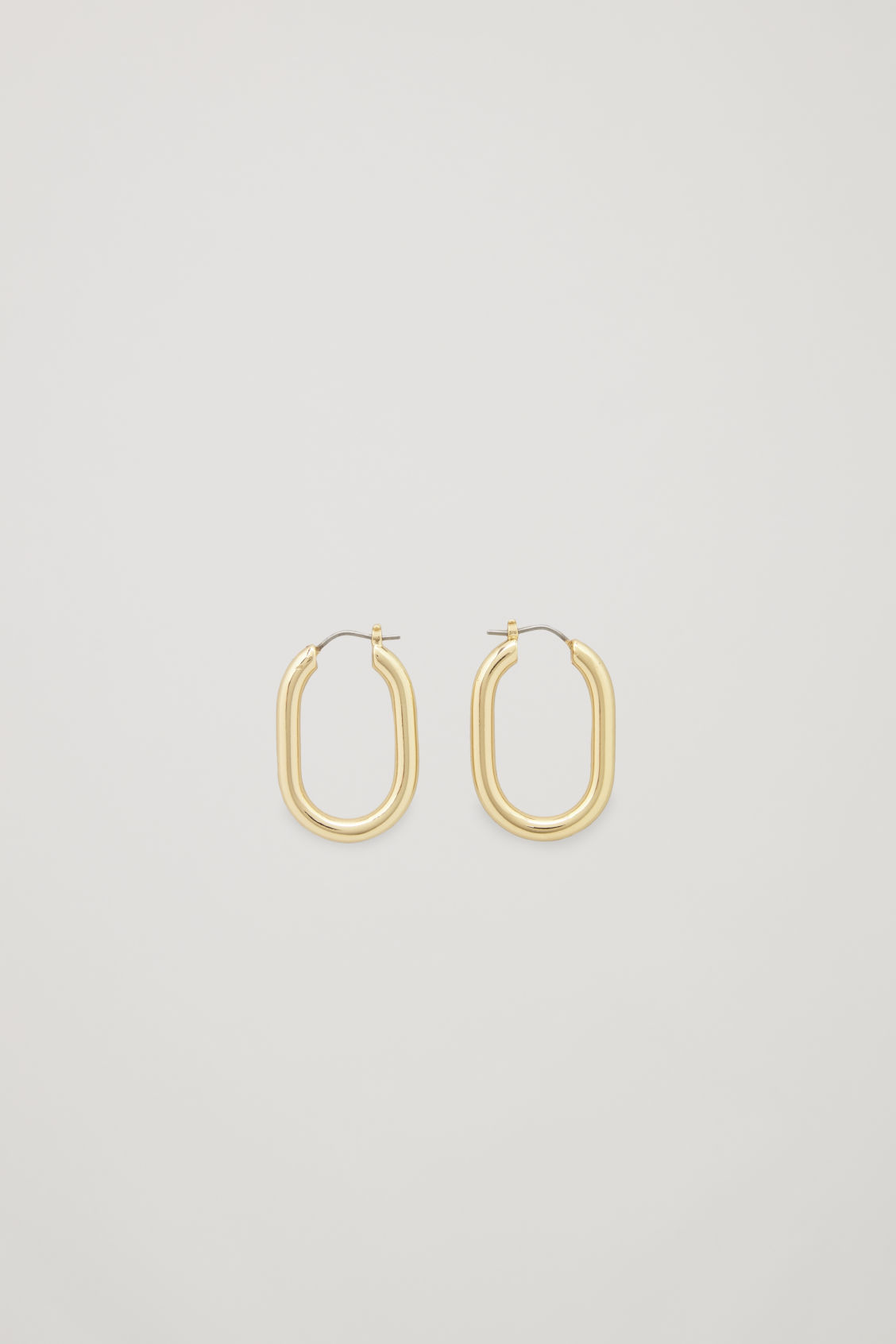 Front image of Cos oval hoop earrings in gold