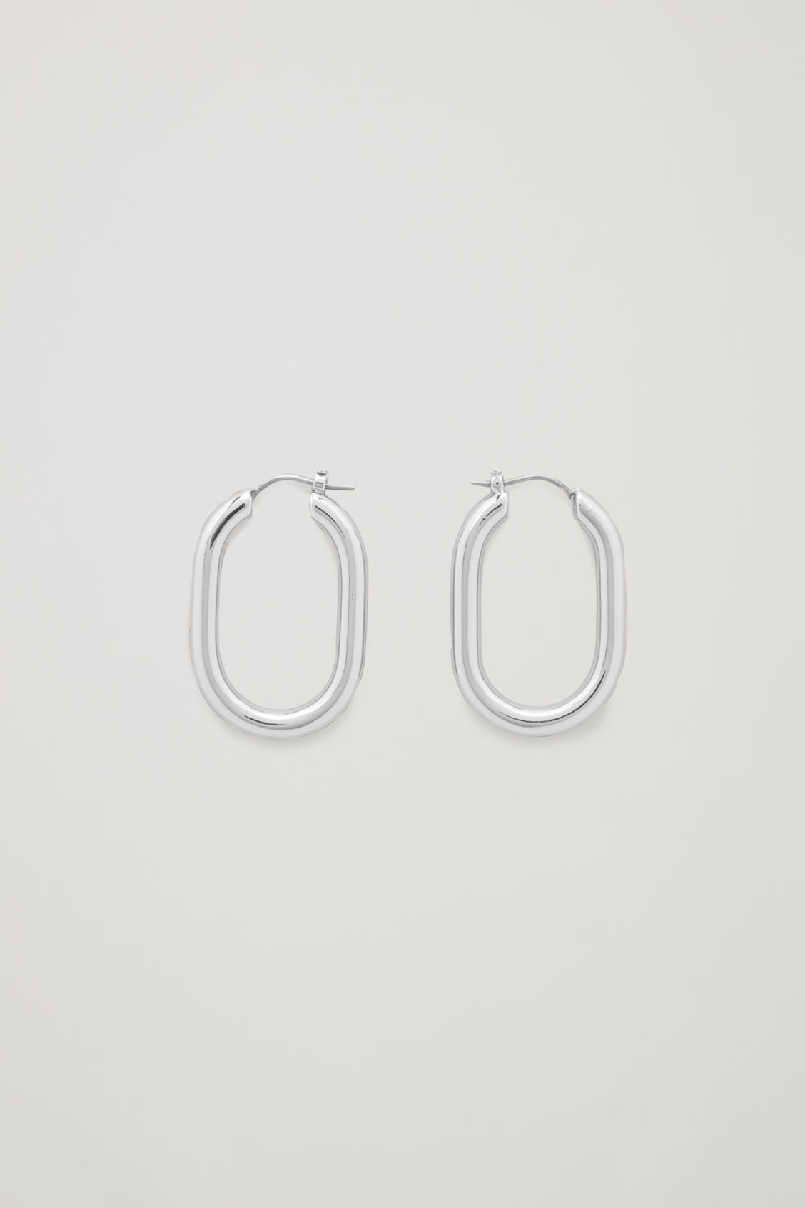Front image of Cos oval hoop earrings in silver