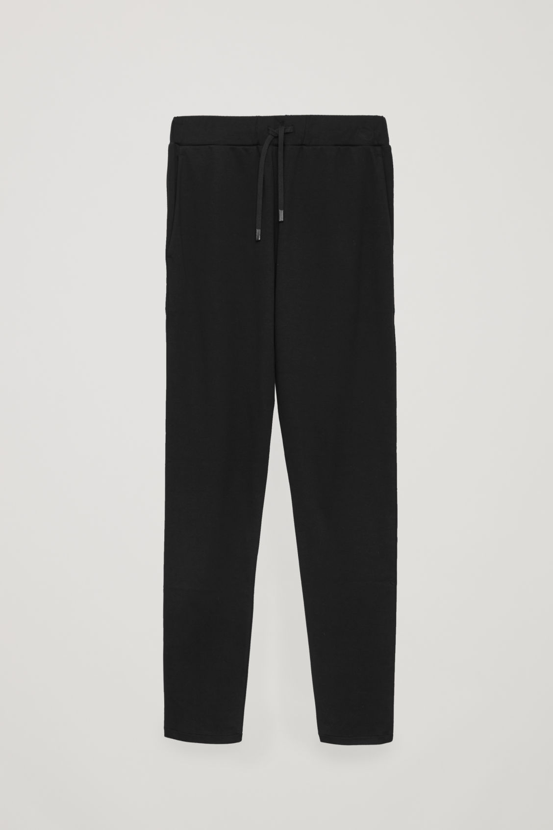 Front image of Cos cotton jogging trousers in black