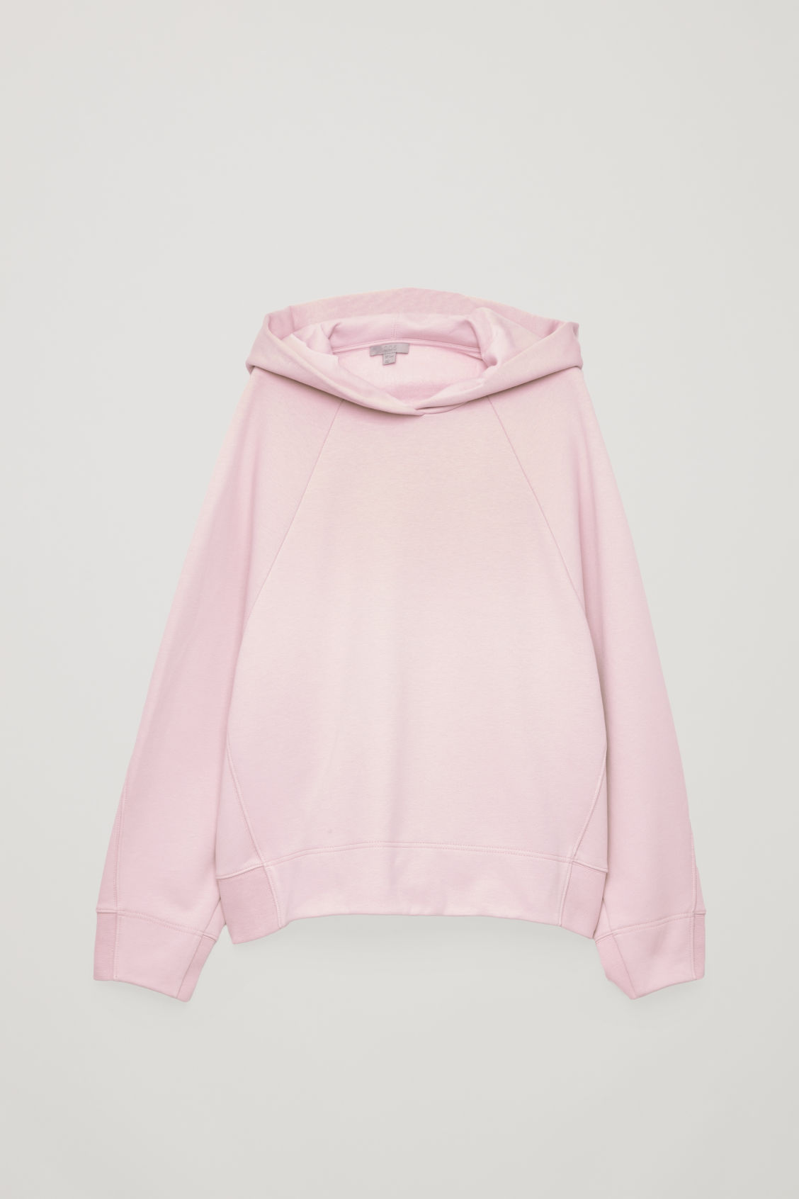 Front image of Cos hooded sweatshirt with wrap seams in pink
