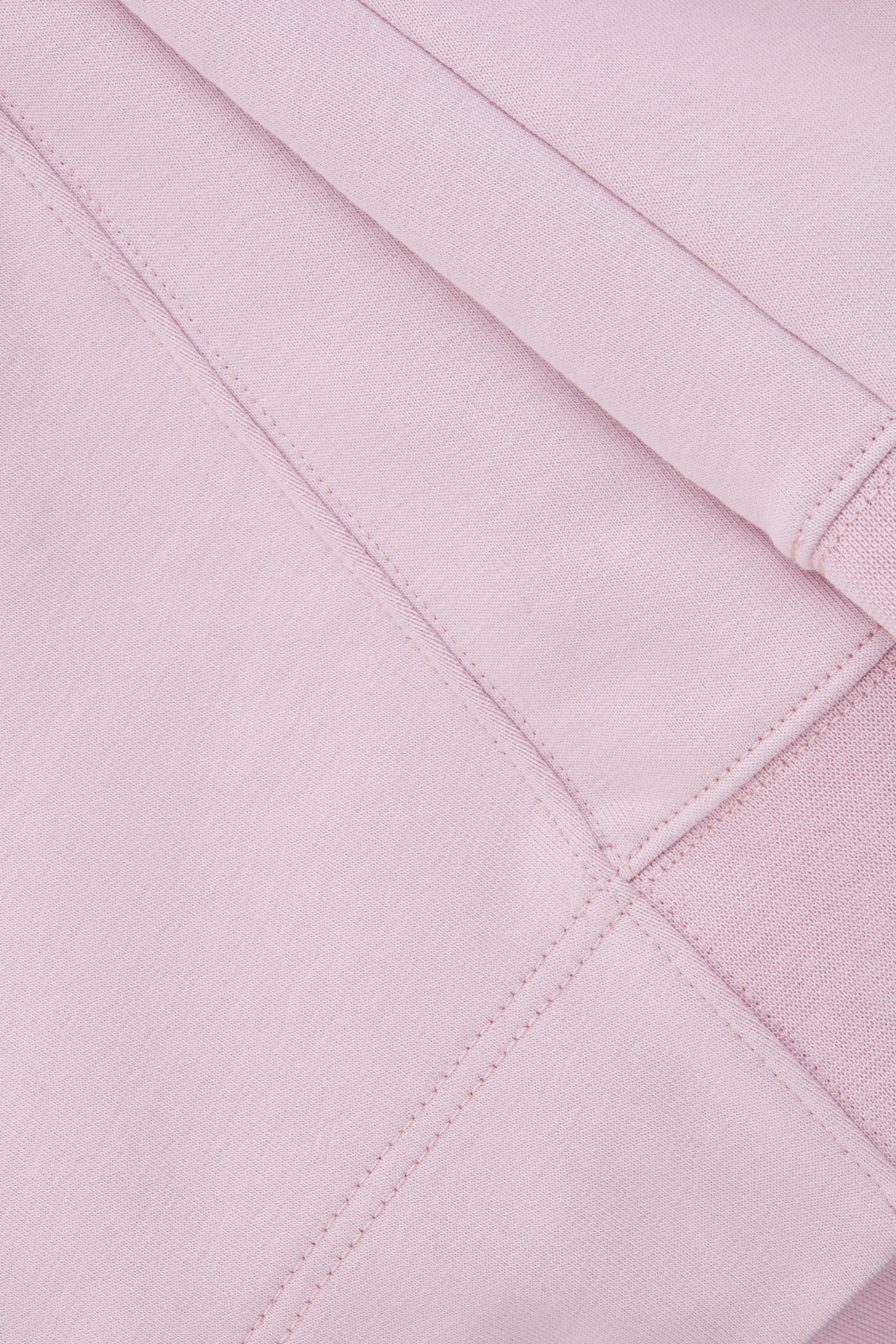 Side image of Cos hooded sweatshirt with wrap seams in pink