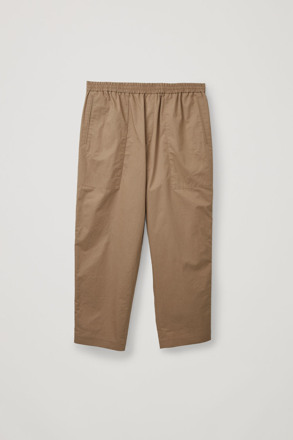 Front image of Cos cargo trousers with jet pockets in beige