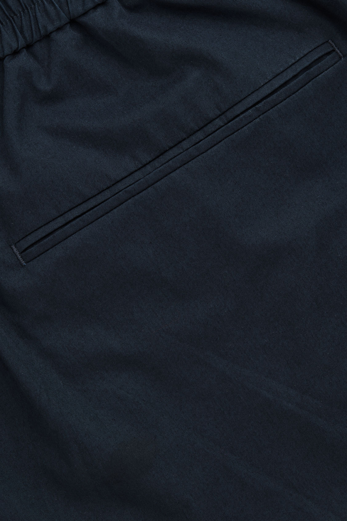 Side image of Cos cargo trousers with jet pockets in blue