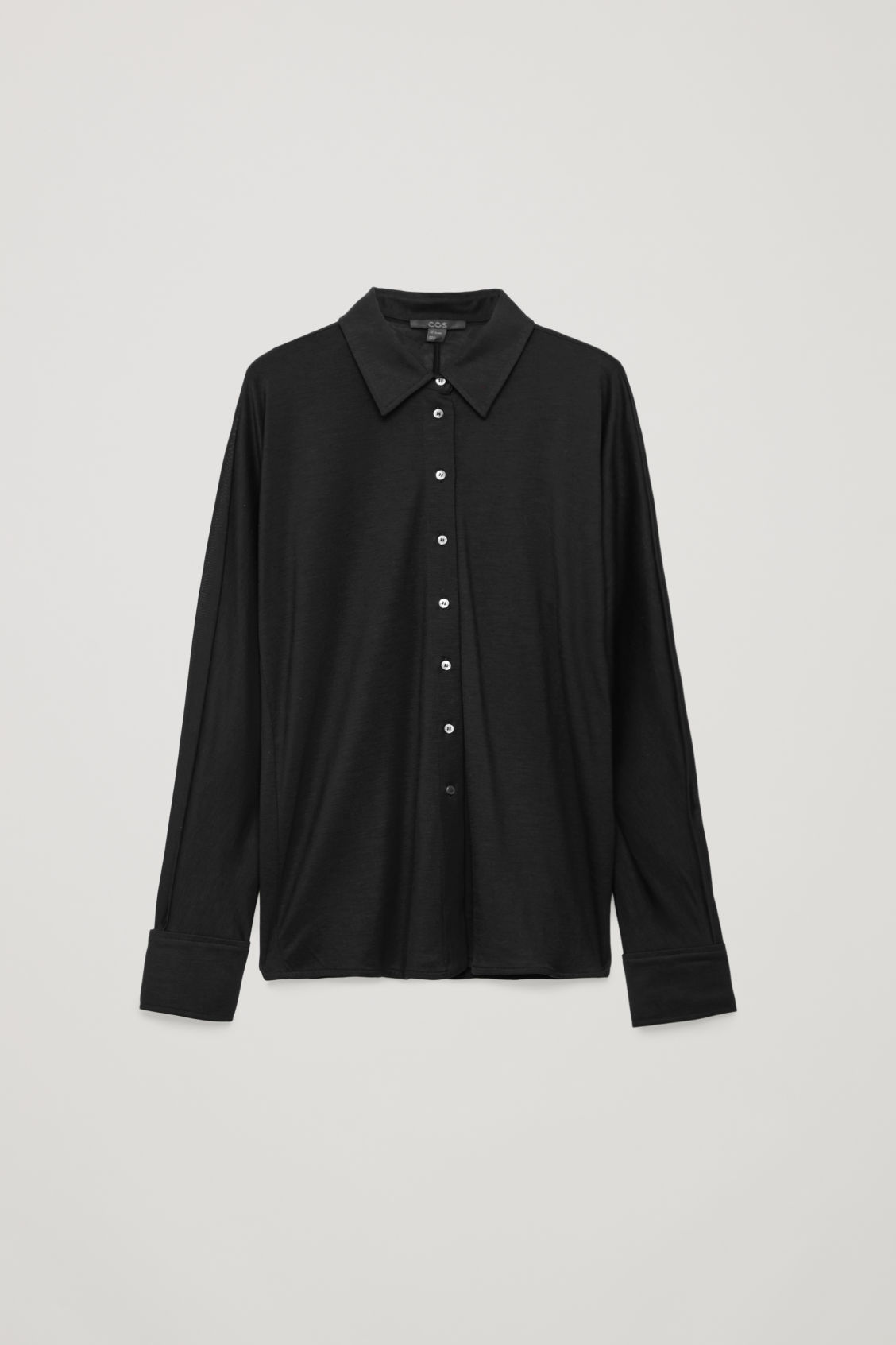 Front image of Cos batwing-sleeved jersey shirt in black