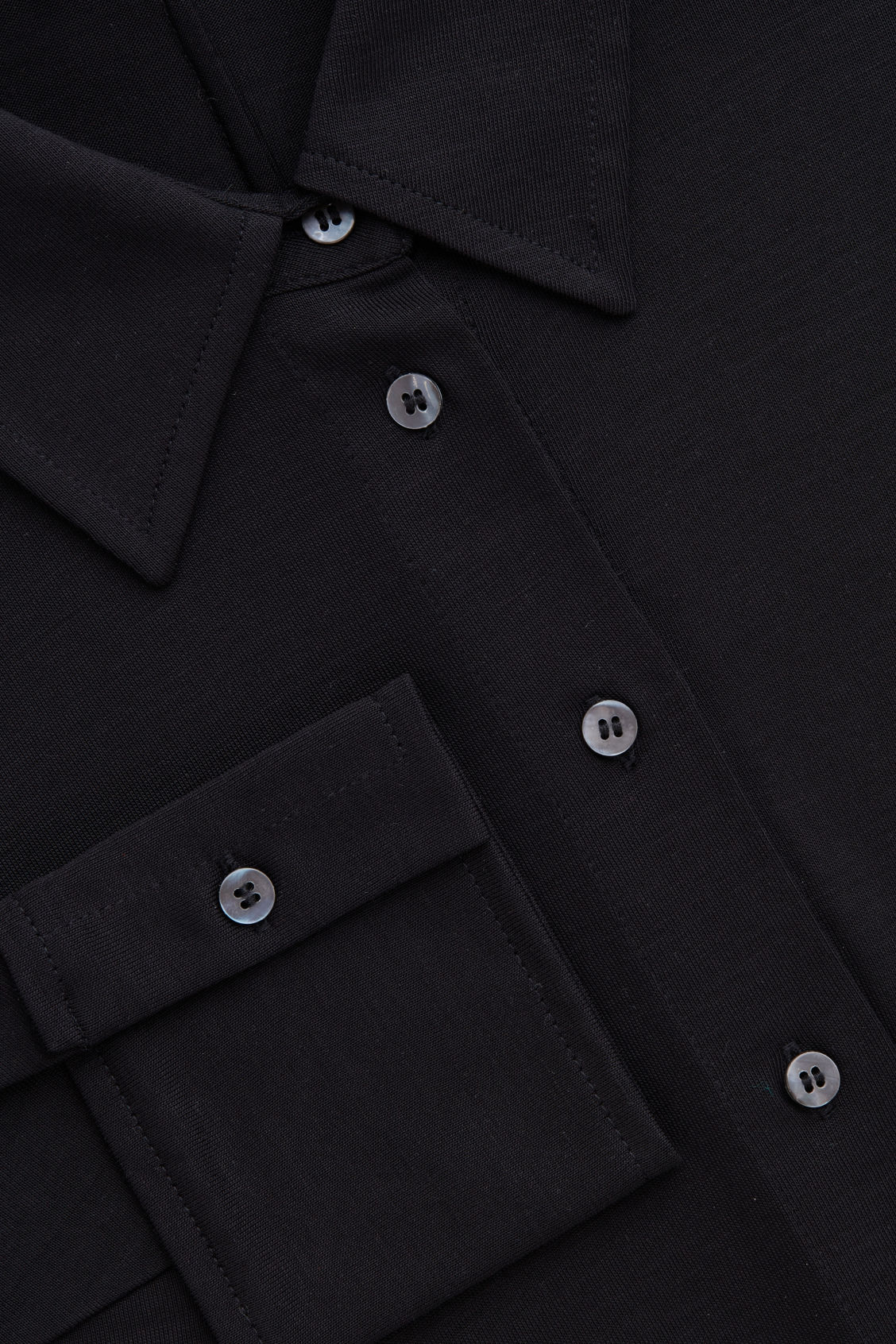 Side image of Cos batwing-sleeved jersey shirt in black