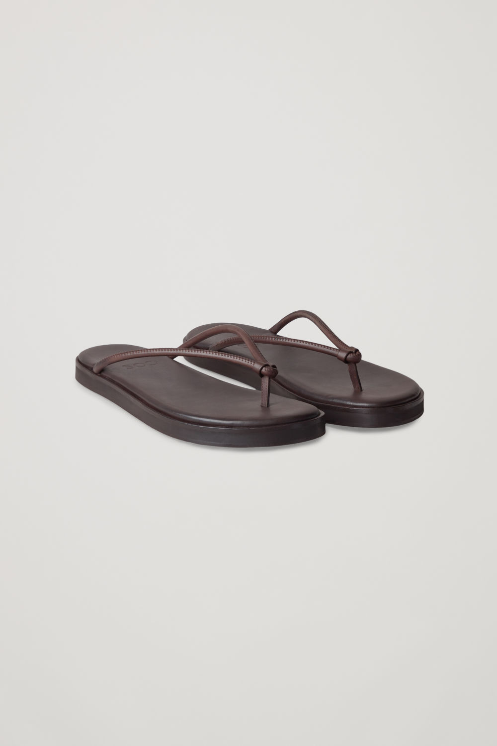 Front image of Cos leather flip flops  in brown