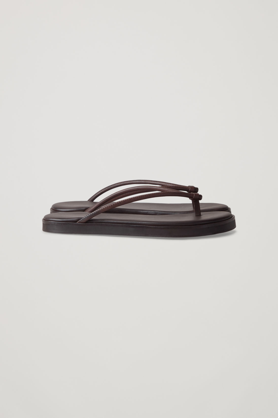 Side image of Cos leather flip flops  in brown