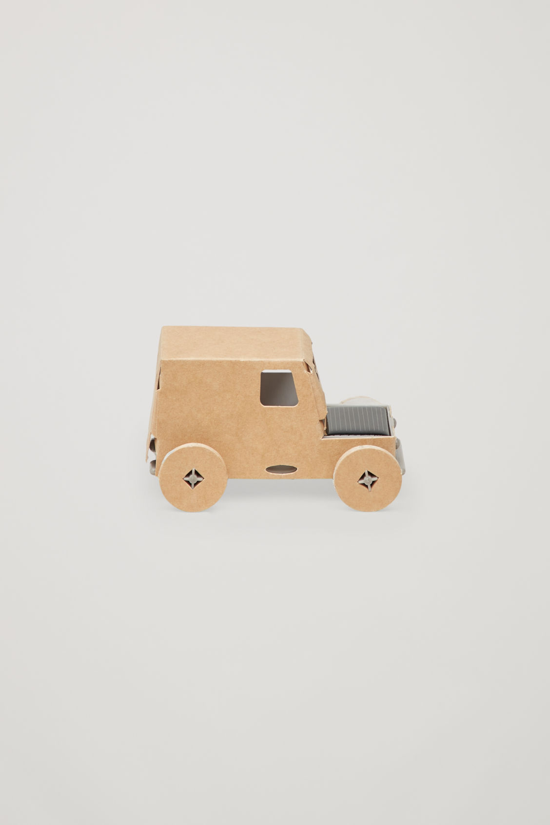 Side image of Cos casagami solar panel car in beige