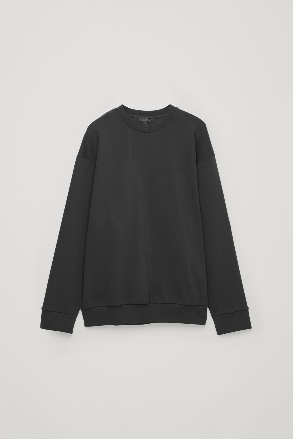 Front image of Cos relaxed jersey sweatshirt in black