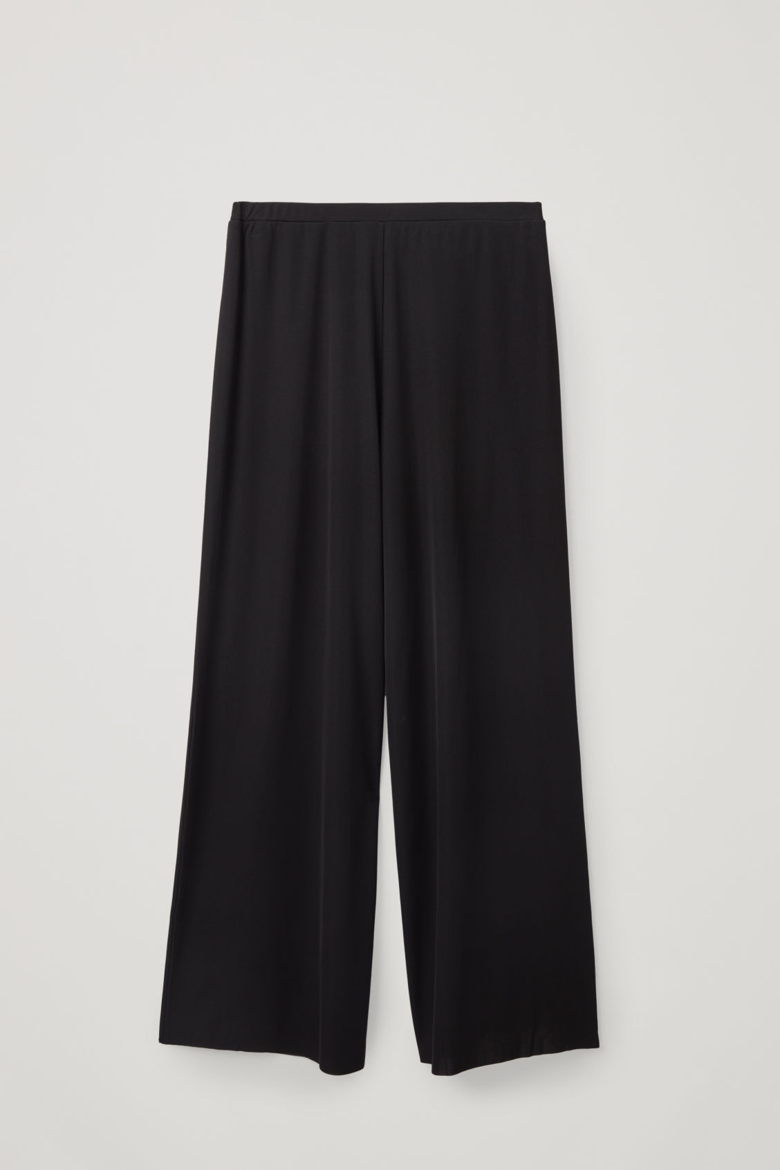 Front image of Cos relaxed elastic-waist trousers in black