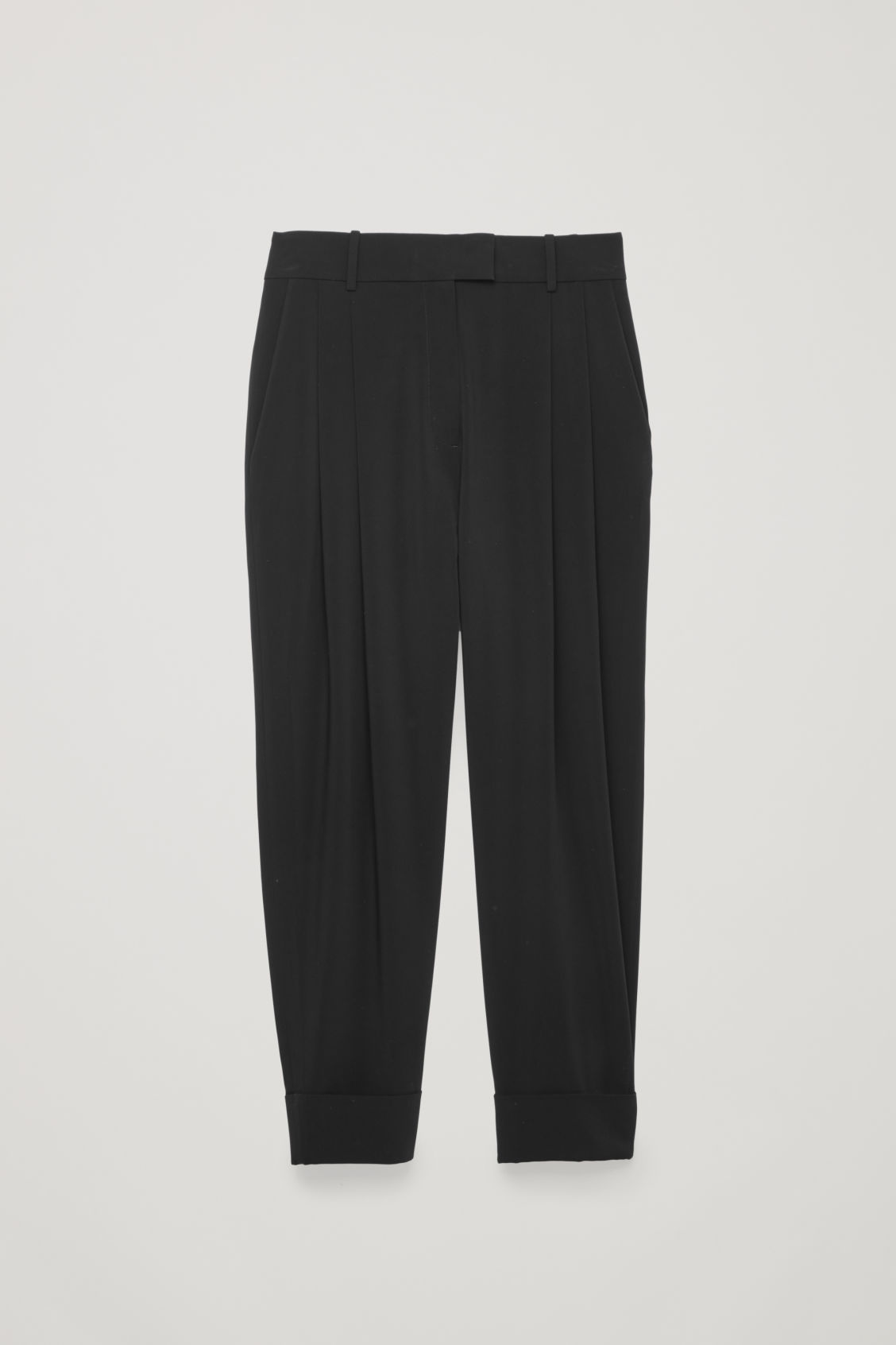 Front image of Cos relaxed pleated trousers in black