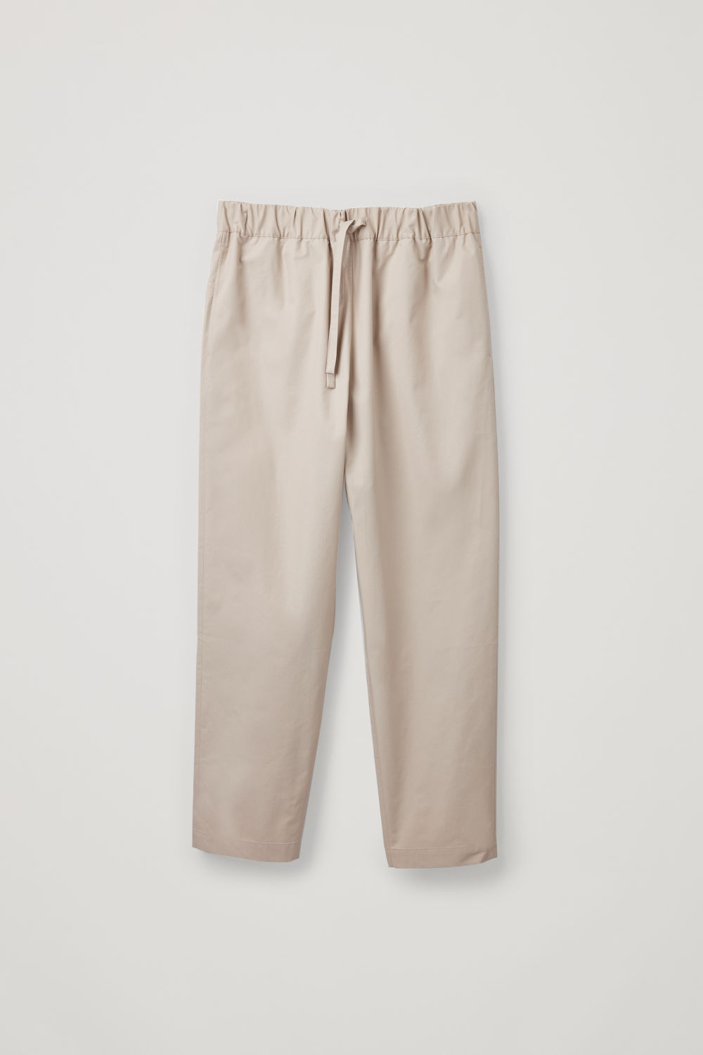 Front image of Cos drawstring poplin trousers in beige