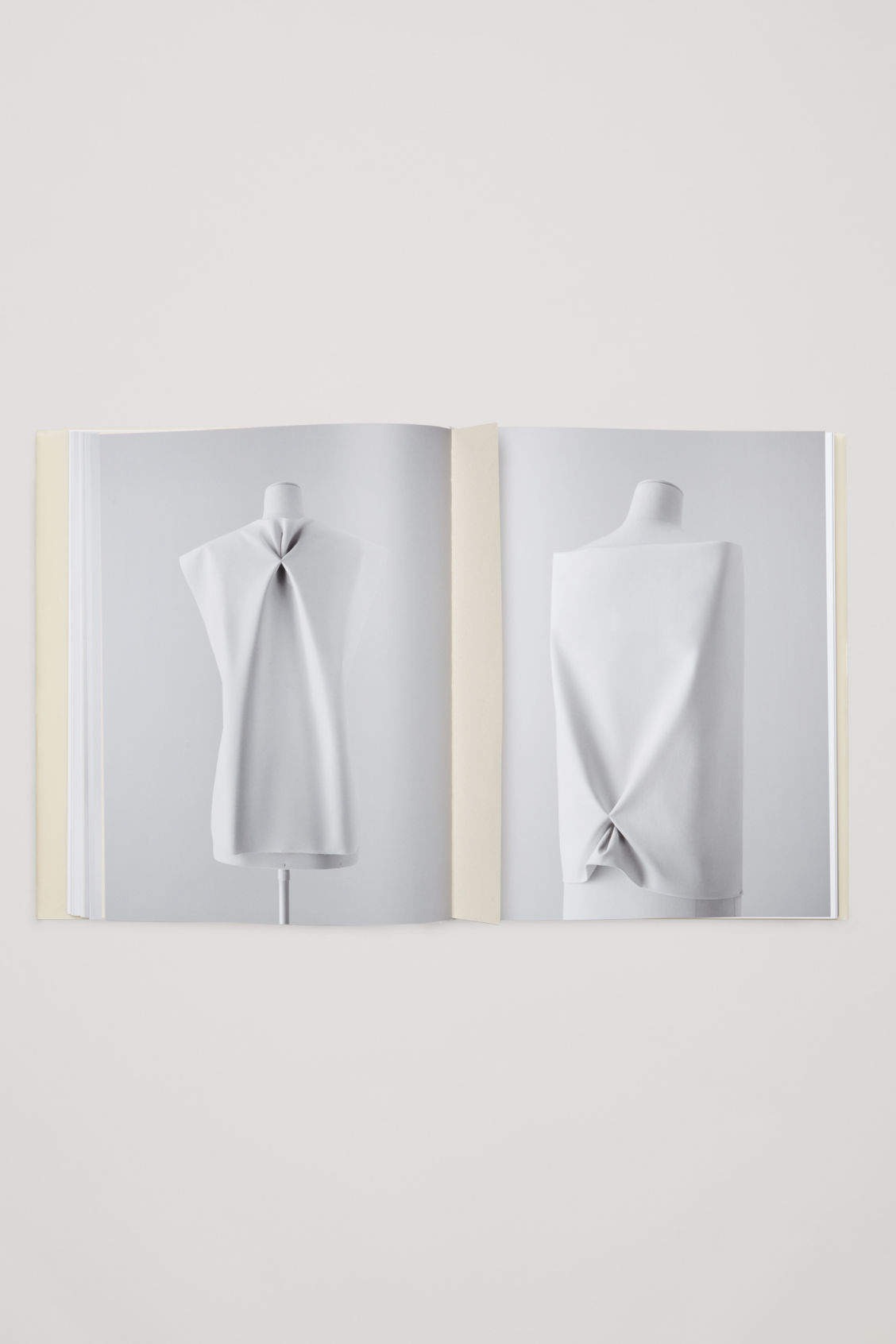 Side image of Cos creating with shapes in white