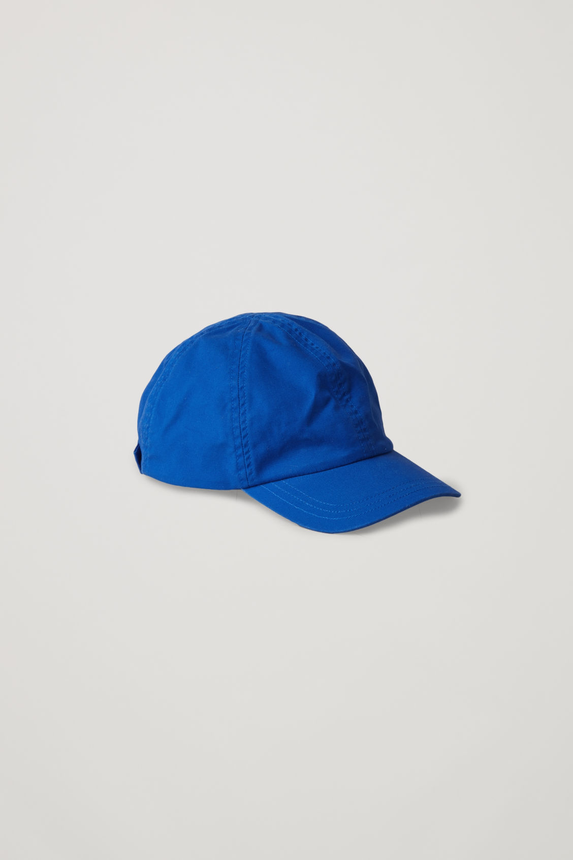 Side image of Cos cotton baseball cap in blue