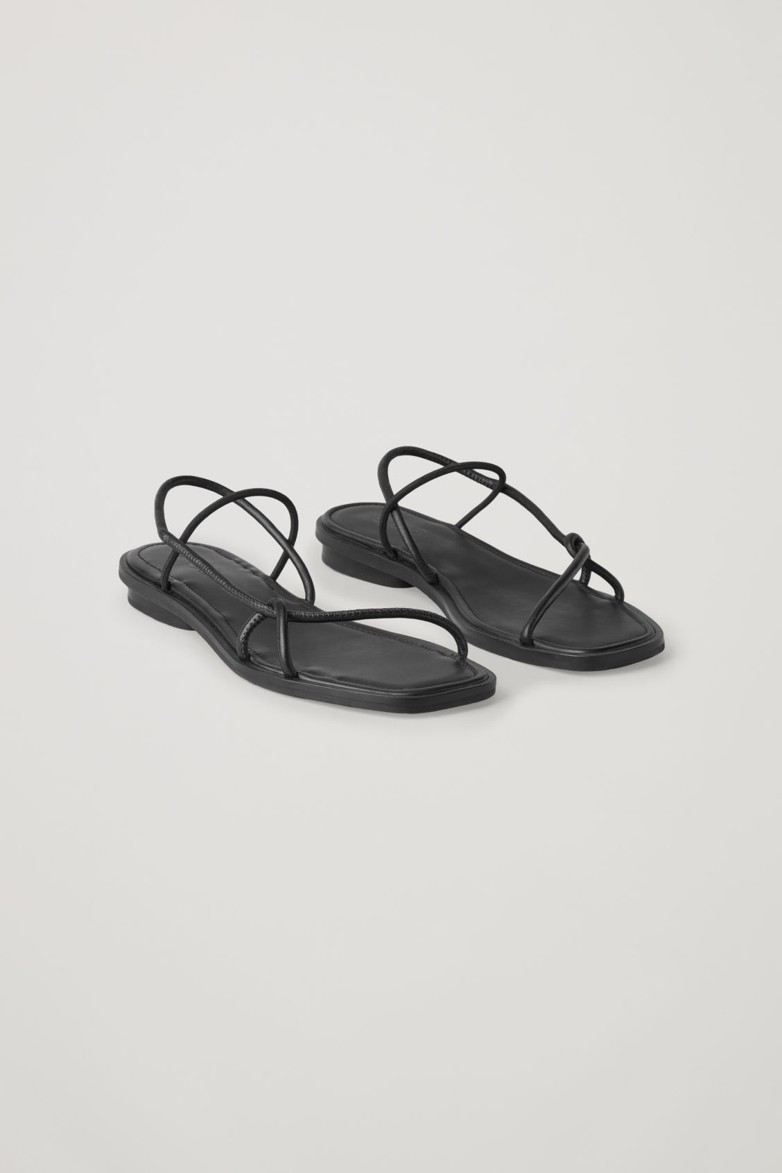 Front image of Cos strappy flat sandals in black