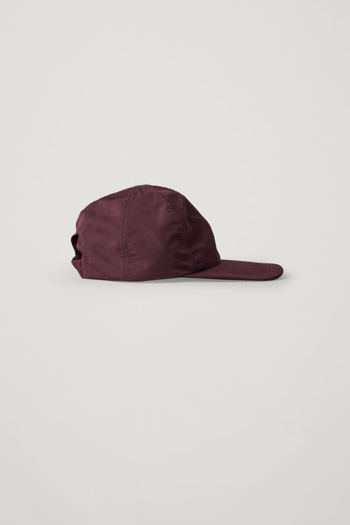 Front image of Cos technical baseball cap in burgundy