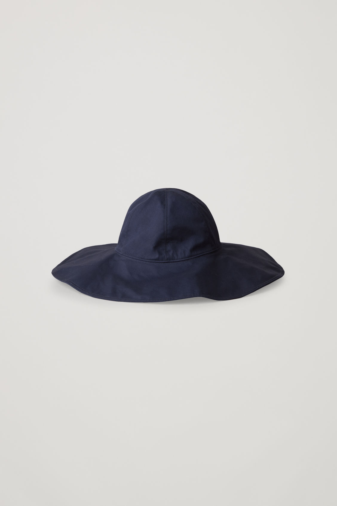 Front image of Cos wide-brim hat with open back in blue