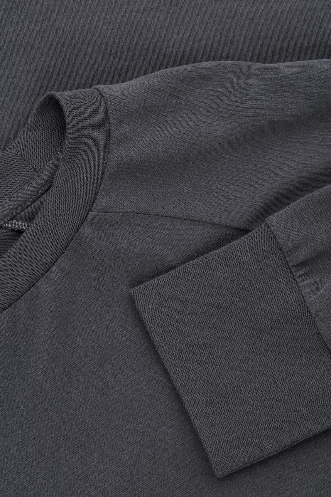 Side image of Cos brushed long-sleeved sweatshirt in black