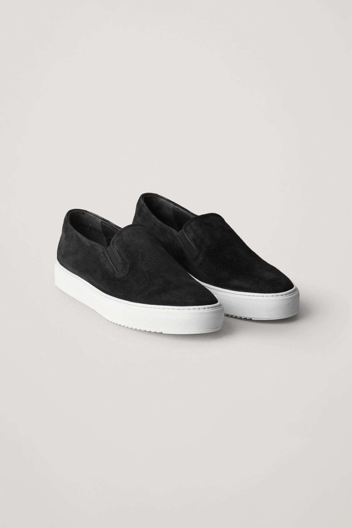 Front image of Cos suede slip-on sneakers  in black