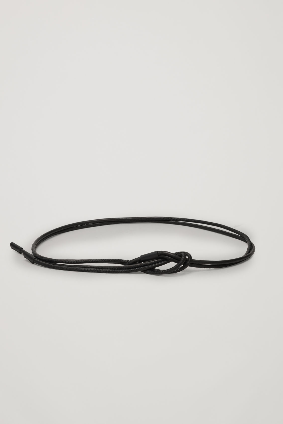Front image of Cos leather rope belt with loop in black