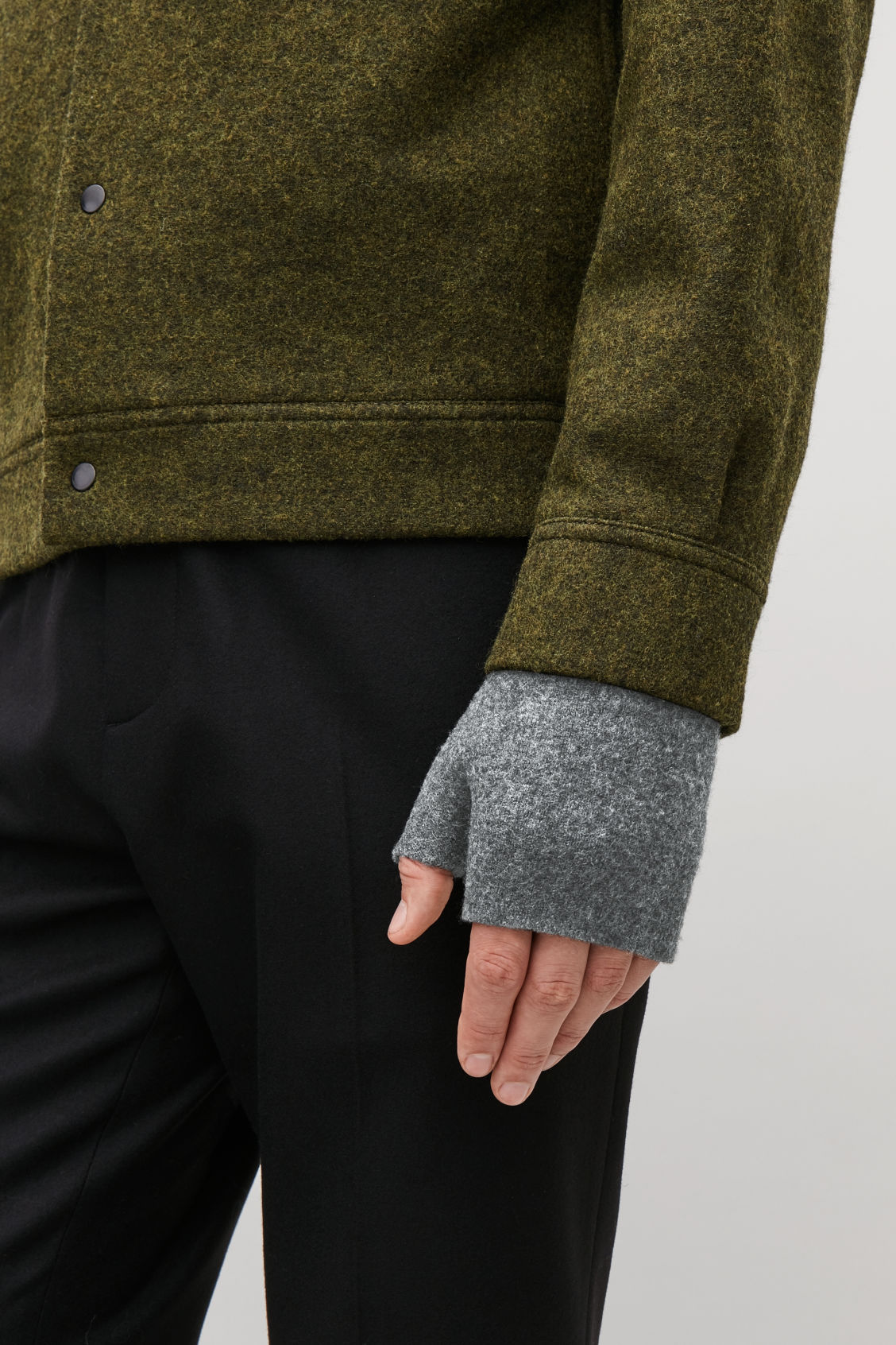 Detailed image of Cos merino fingerless gloves in grey