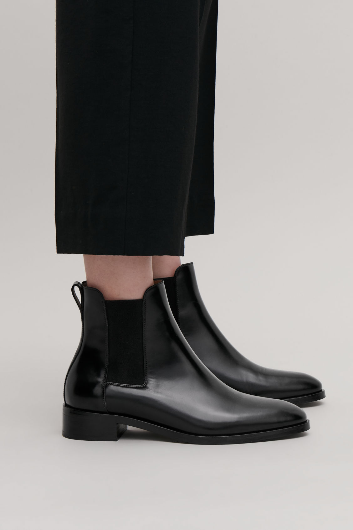 Detailed image of Cos chelsea boots in black