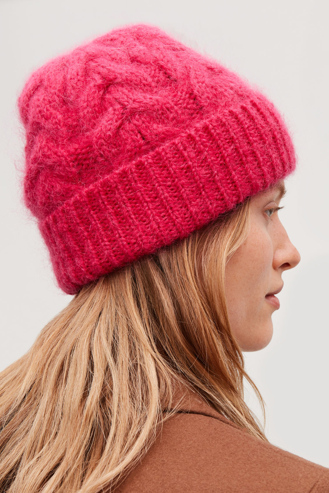 Detailed image of Cos cable-knit hat in pink