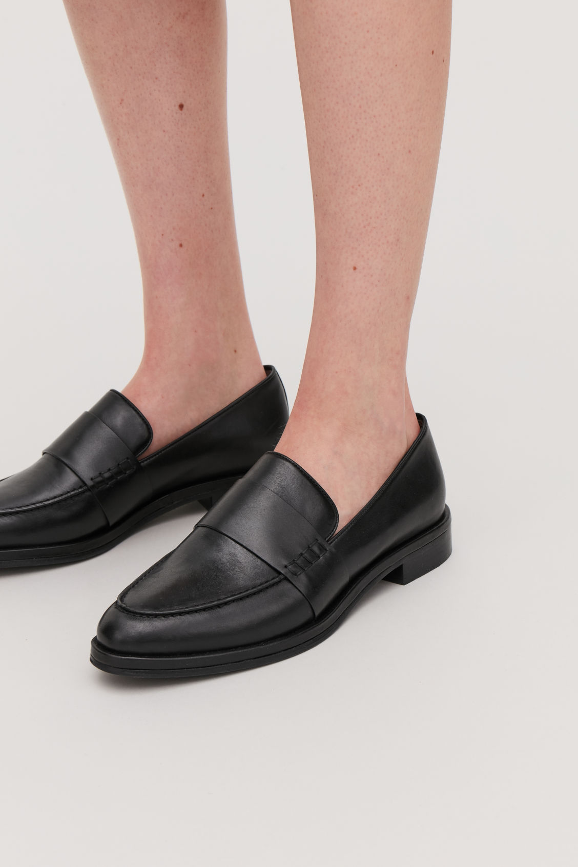 Detailed image of Cos leather loafers in black