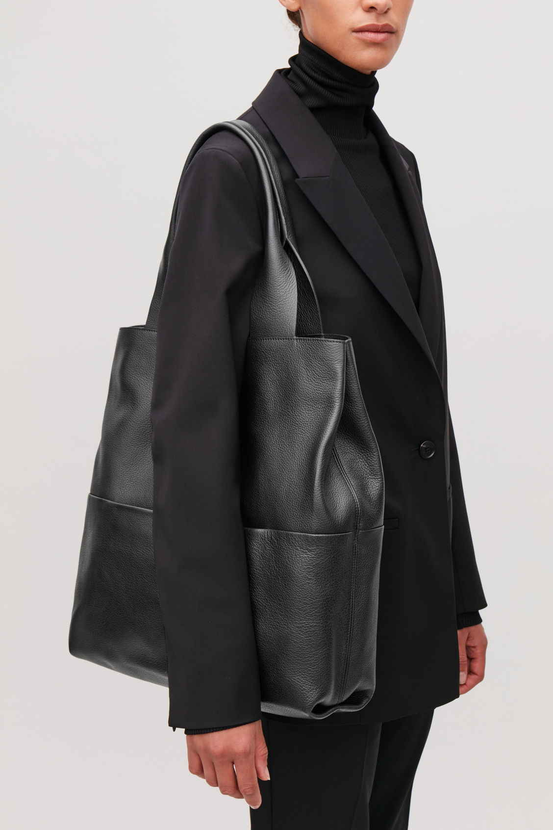 Detailed image of Cos large grained leather bag in black e04731166c9d2