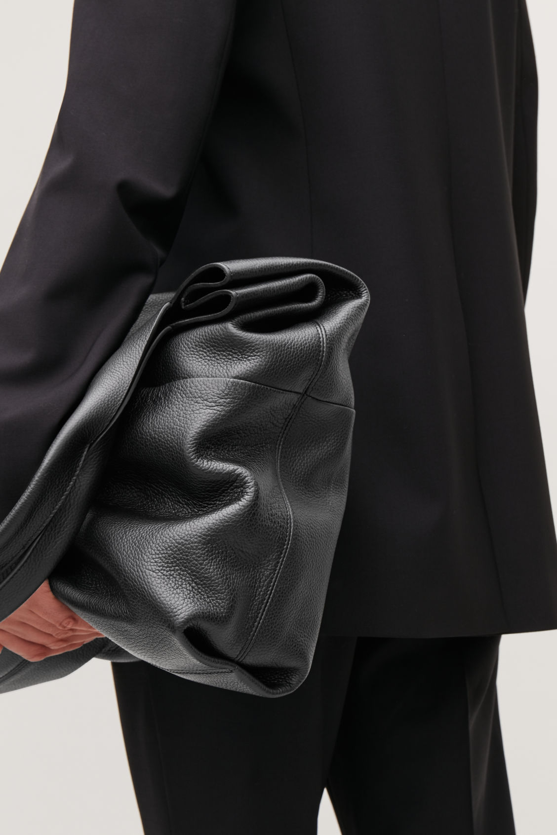 Detailed image of Cos large grained leather bag in black