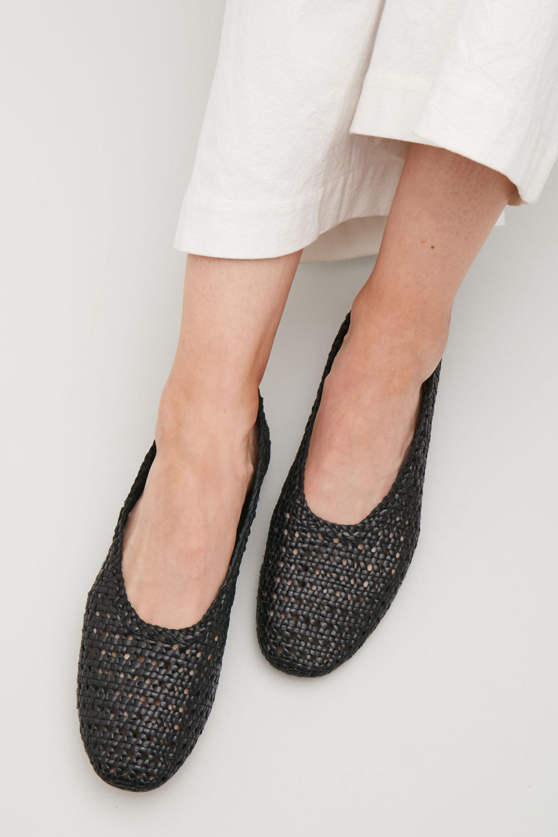 Detailed image of Cos braided slip-on shoes in black