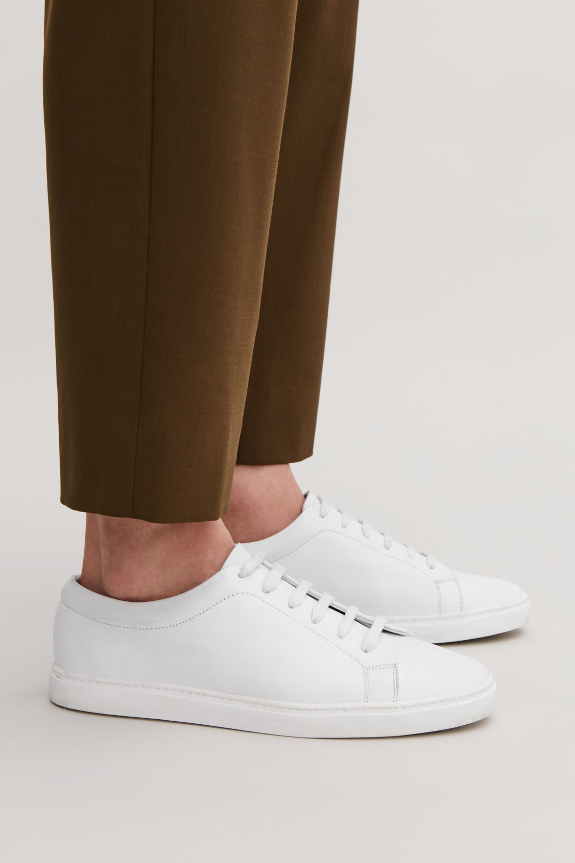 Detailed image of Cos slim-sole lace-up sneakers in white