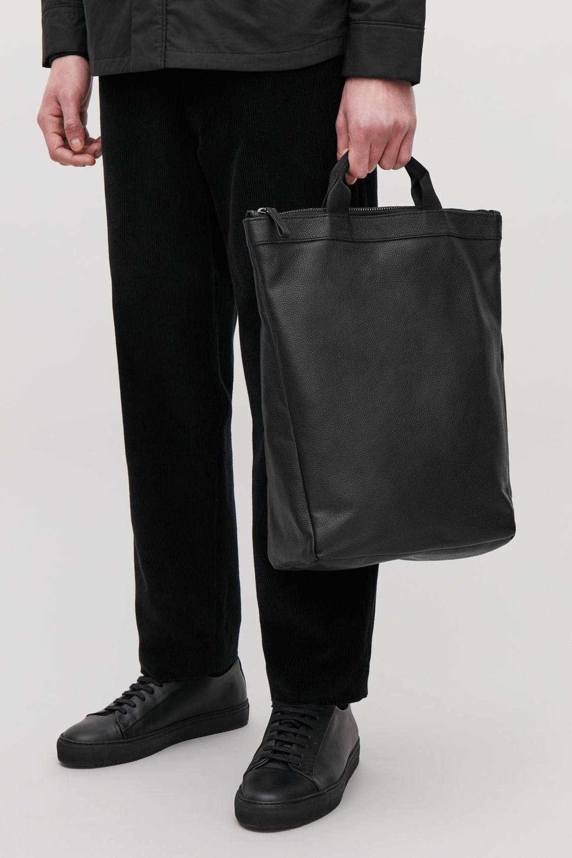 Detailed image of Cos leather tote backpack in black