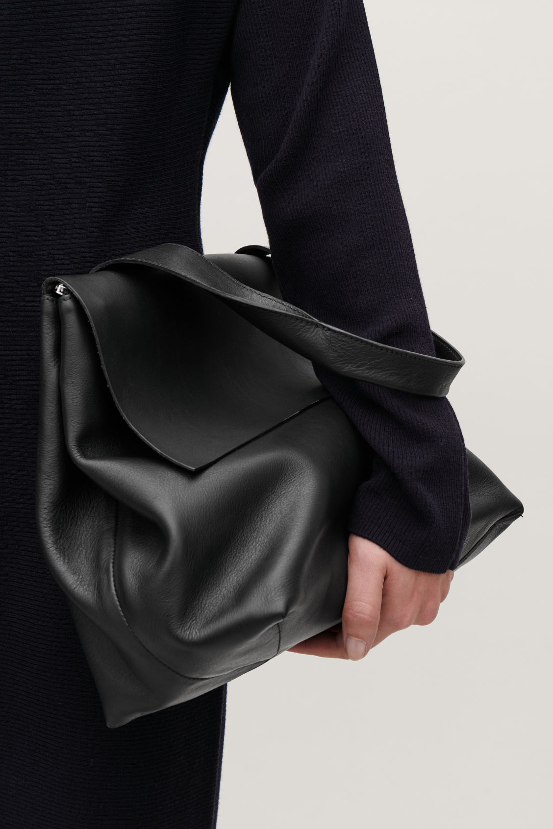 Detailed image of Cos leather tote bag with strap in black