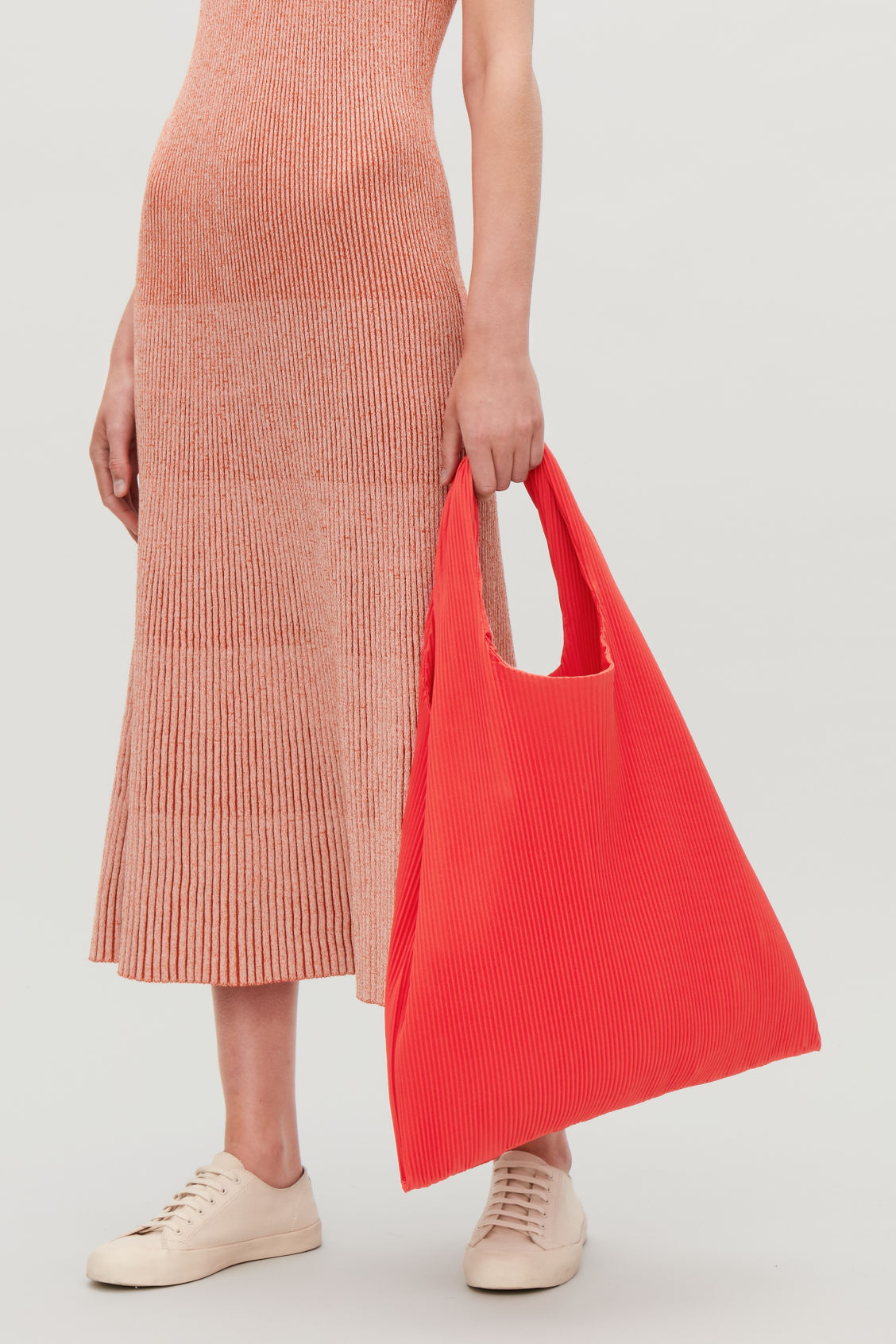 Detailed image of Cos pleated fabric shopper in red
