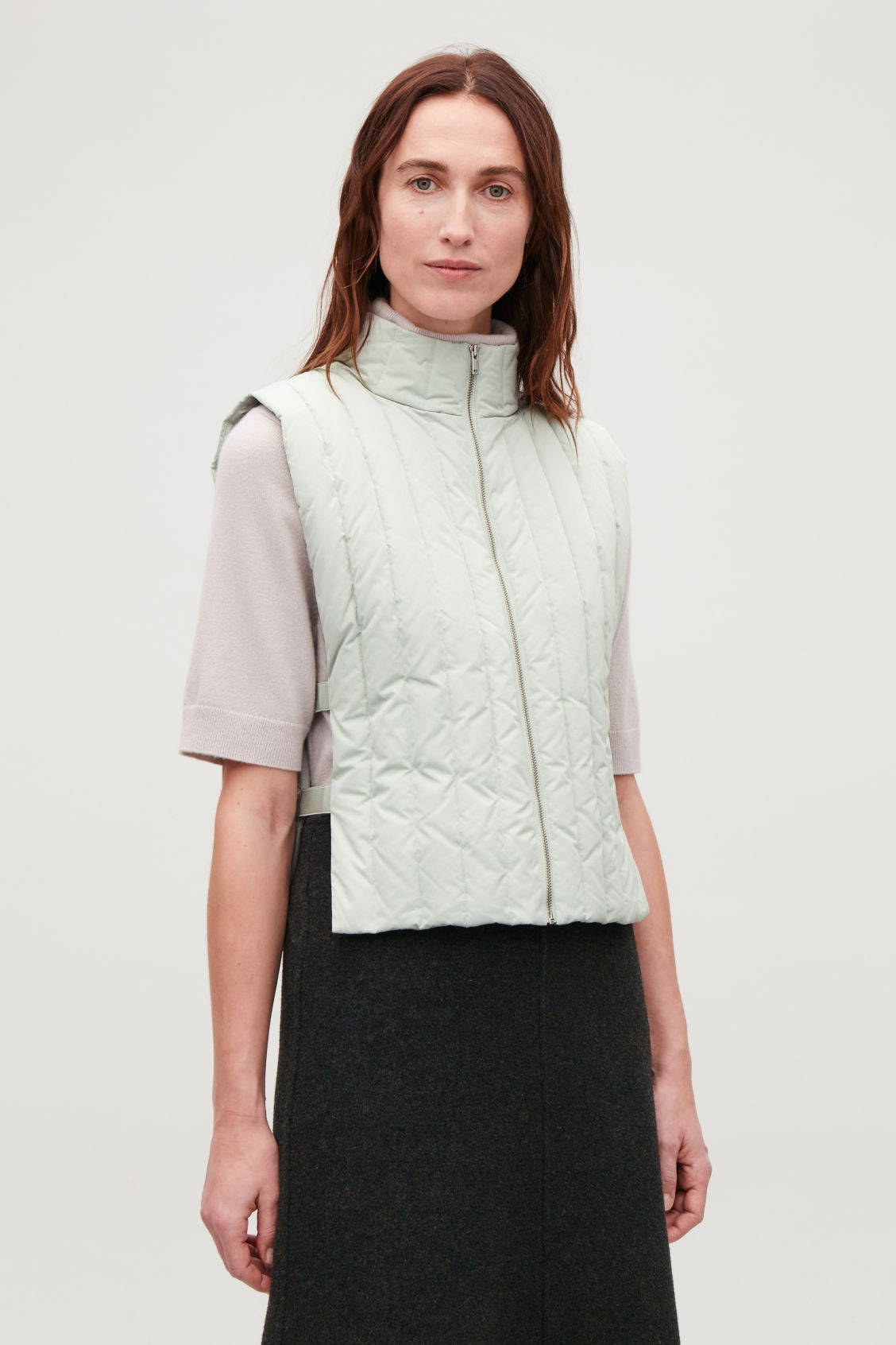 Detailed image of Cos padded gilet with elastic detail in green