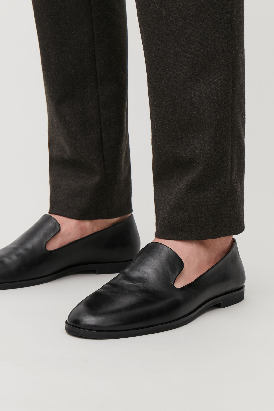 Detailed image of Cos leather slip-on shoes in black