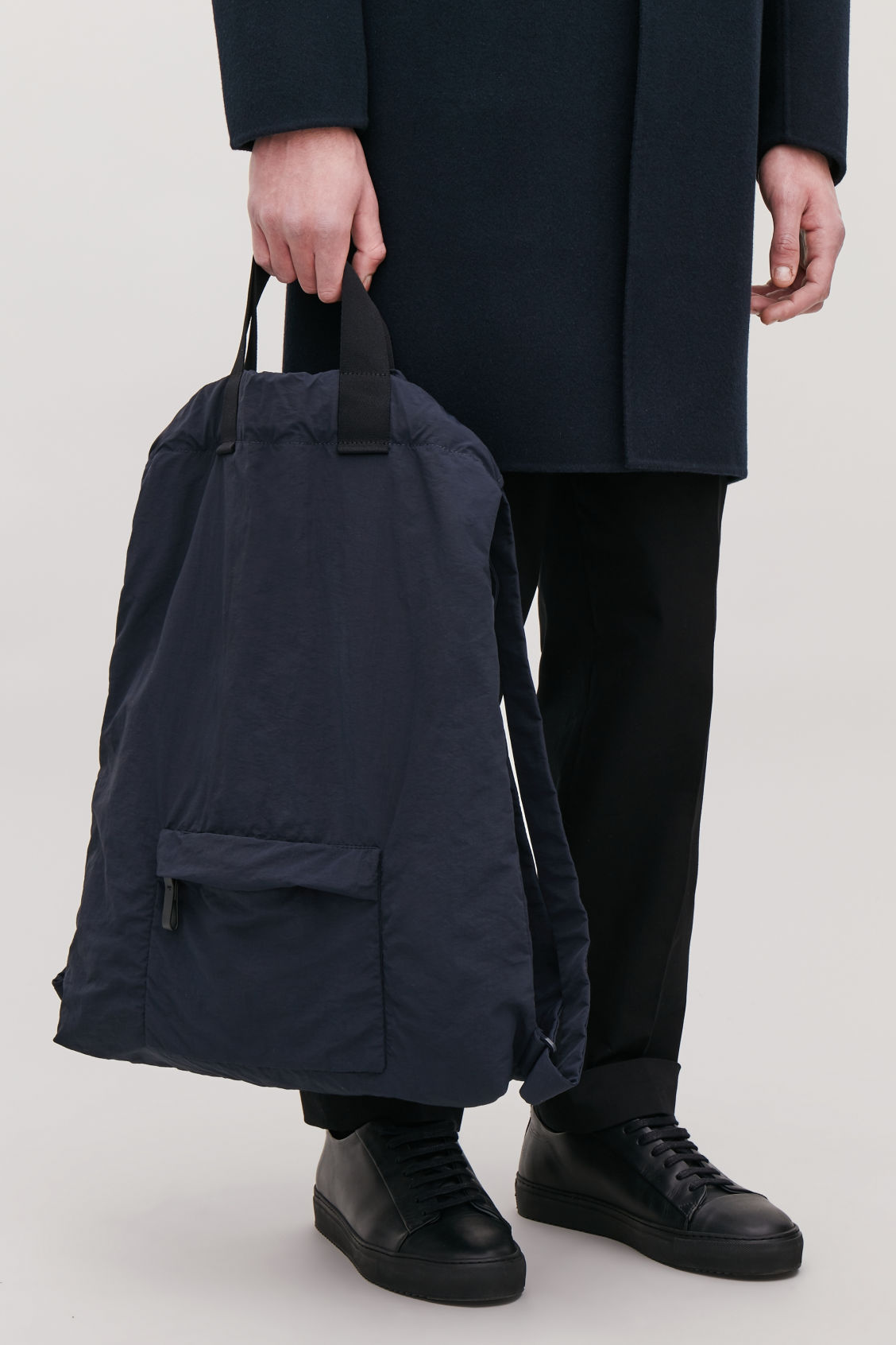 Detailed image of Cos technical drawstring backpack  in blue