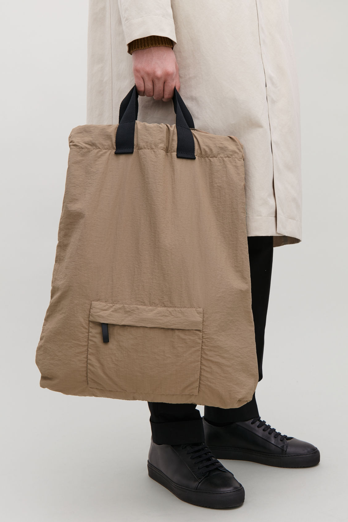 Detailed image of Cos technical drawstring backpack  in beige