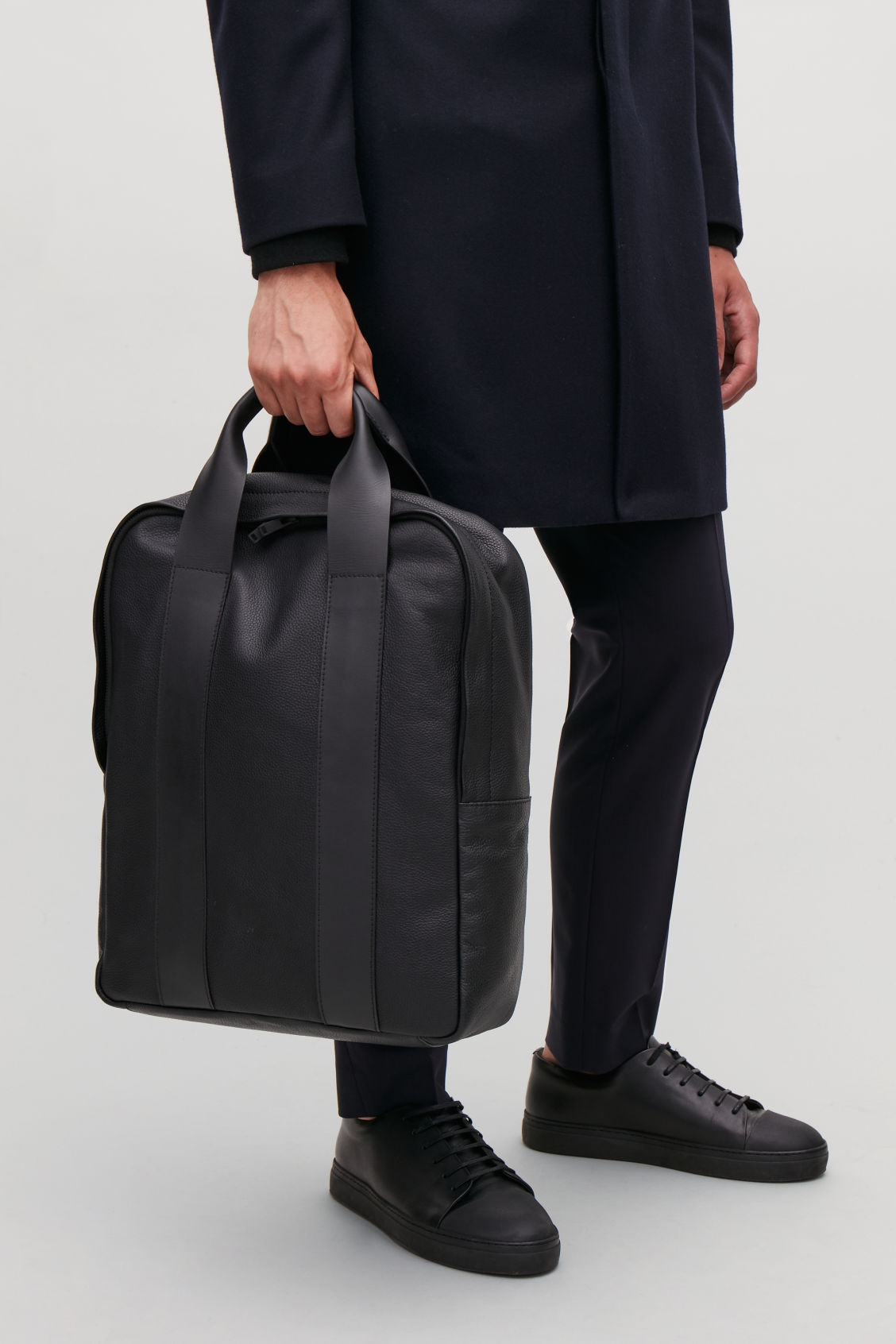 Detailed image of Cos grained leather tote backpack in black