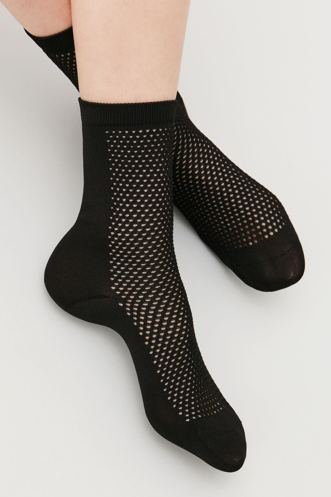Detailed image of Cos crochet patterned ankle socks in black