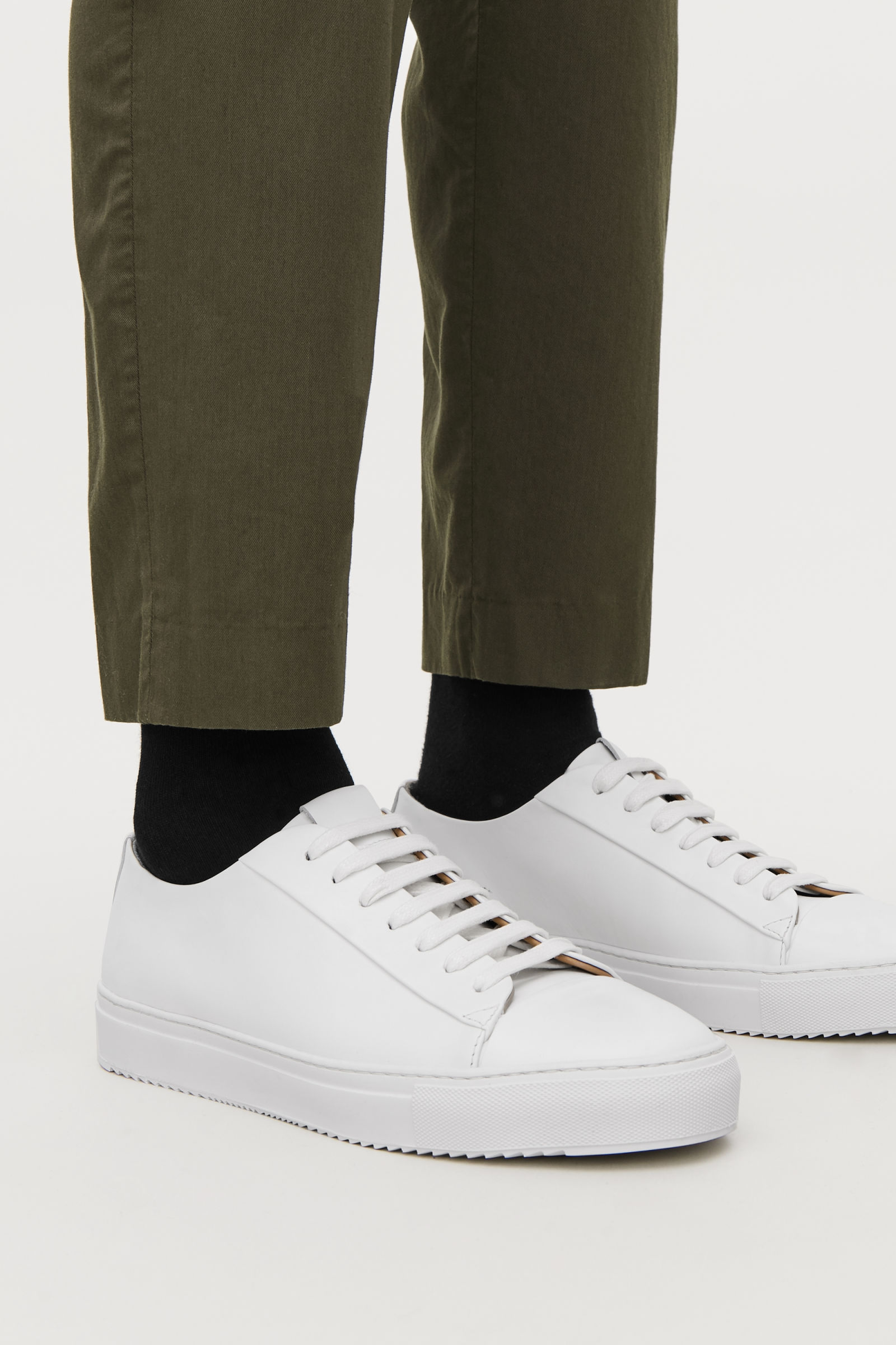 white leather lace-up trainers