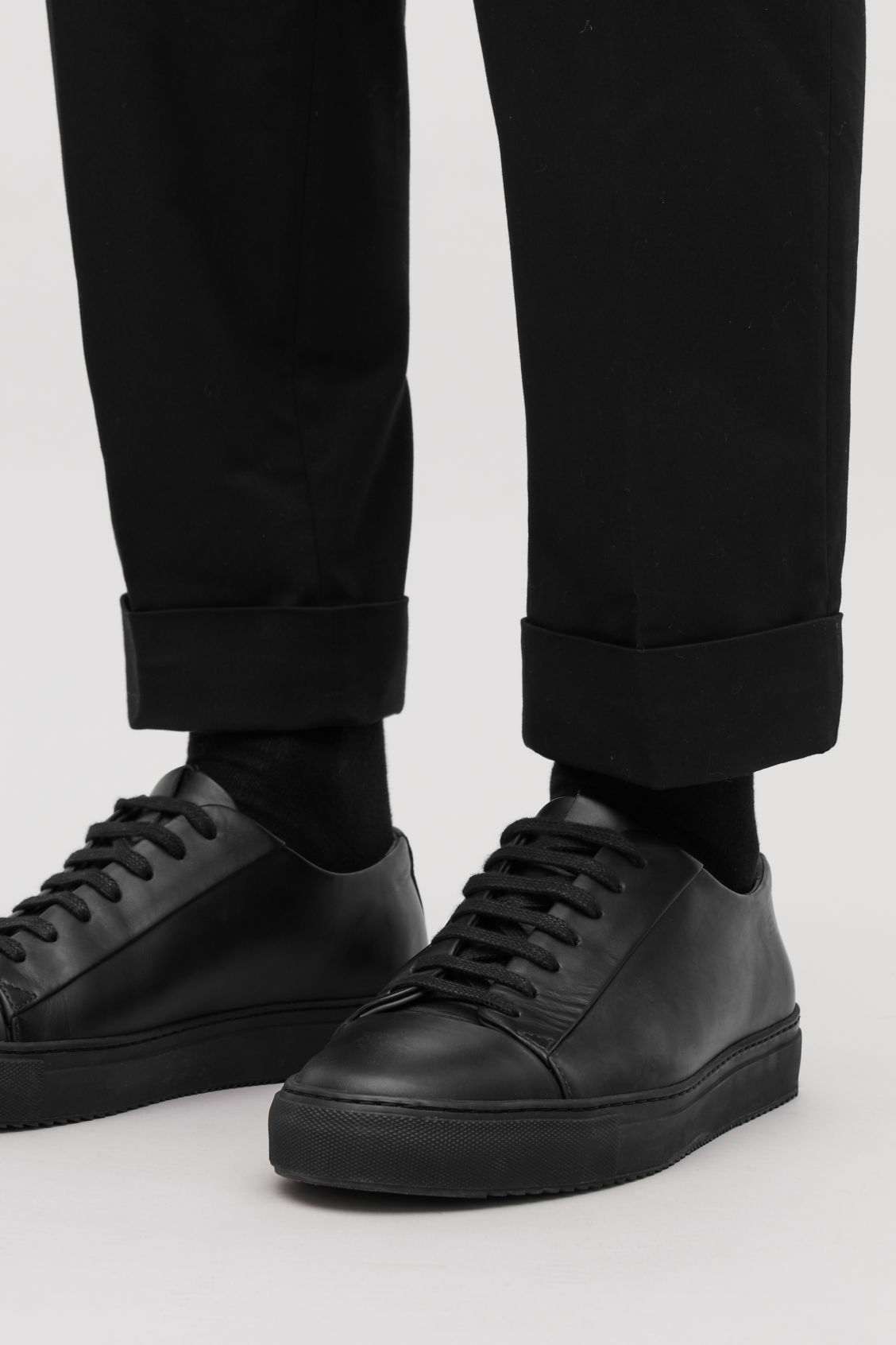 Detailed image of Cos thick-soled leather sneakers in black