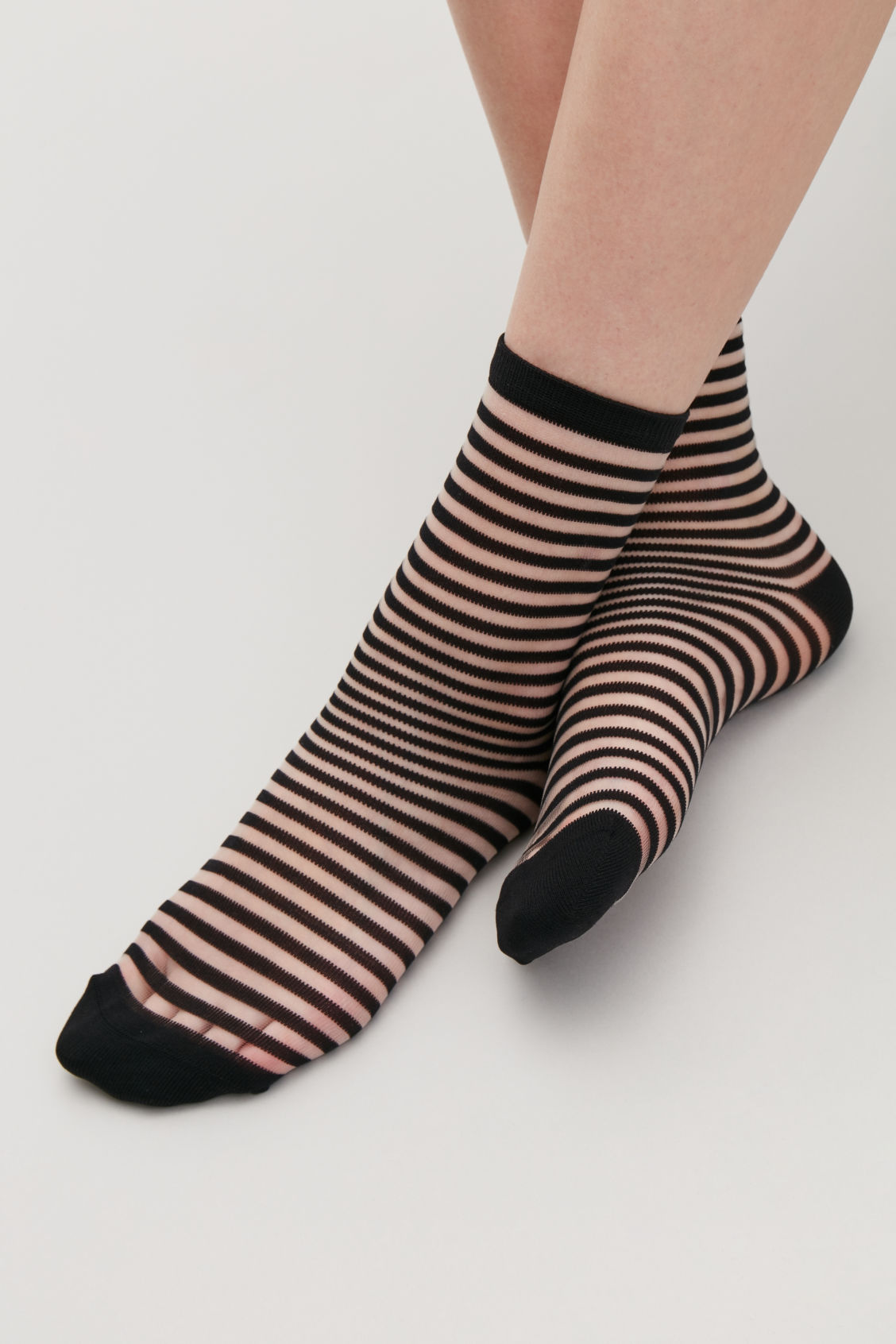 Detailed image of Cos striped sheer socks in black
