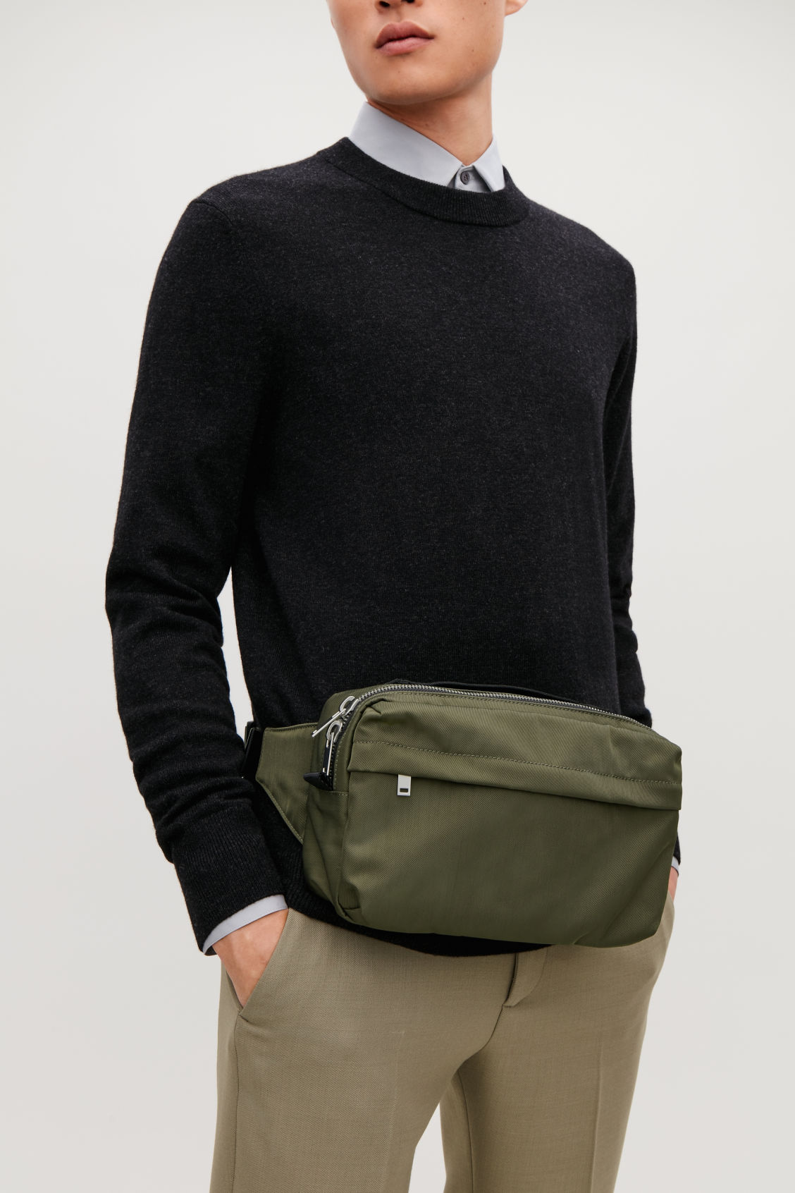 Detailed image of Cos technical belt bag in green